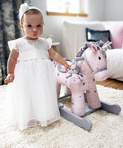 grey and white unicorn rocking horse