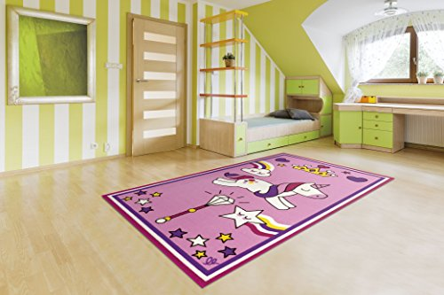 Fun pink unicorn rug featuring stars rainbows clouds and crowns! Perfect for kids playroom or bedroom