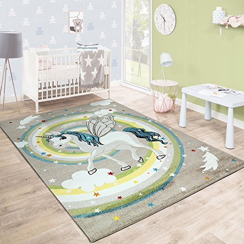 Beautiful unicorn rainbow rug for children's / kids bedroom, playroom, nursery. Soft beige and pastel colours.
