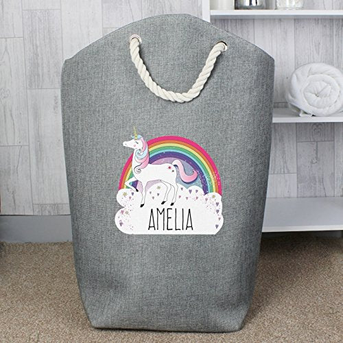 Personalised unicorn storage bag. Can be used as a laundry bag, or toy storage. Features a cute unicorn, rainbow and cloud design with a personalised name feature.