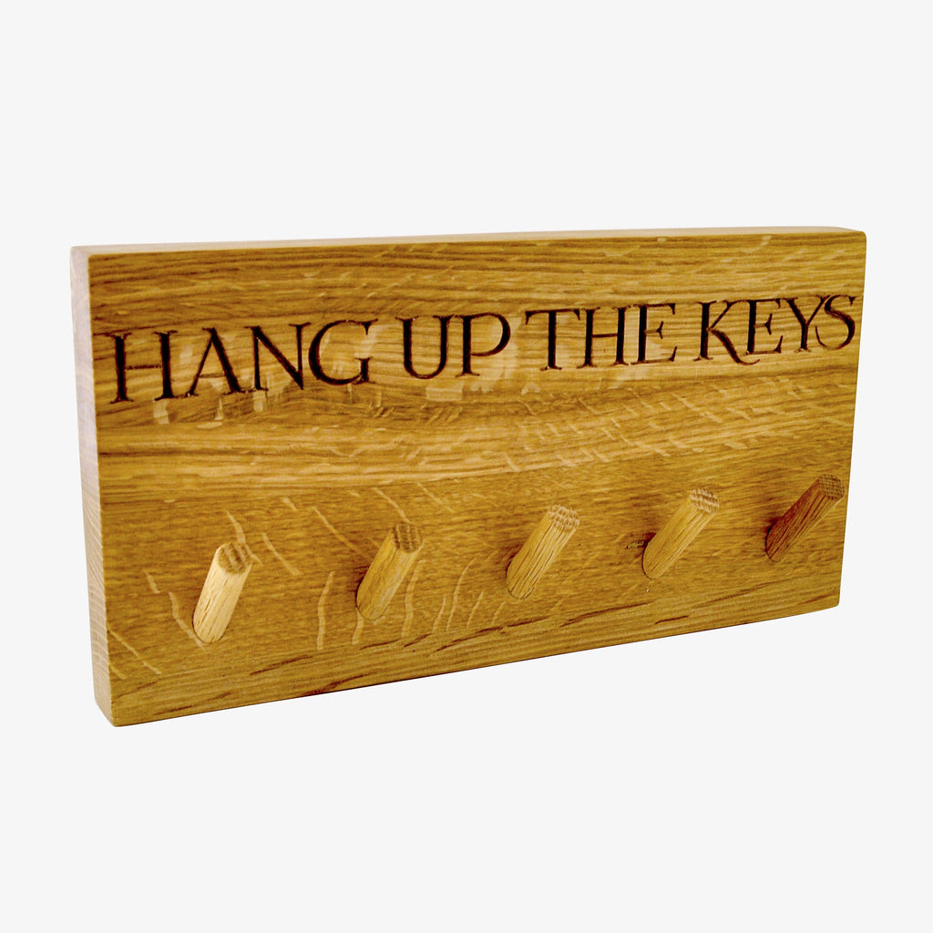 Emma Bridgewater Black Toast Wooden Key Hook with text that says 'HANG UP THE KEYS', gift to a friend or a family member for a reminder to hang the keys