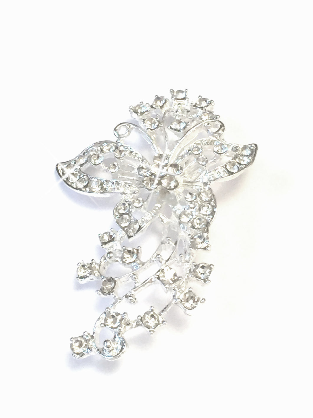 Sparkling Butterfly Brooch, This beautiful brooch is intricately designed with sparkling crystals, embracing a silver toned metal vine with a beautiful distinguished butterfly, with a pin & catch fastening