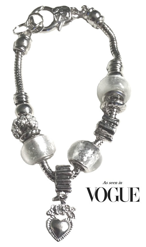 Padua Charm Bracelet by SommerSparkle, as seen in Vogue, this stunning genuine Italian Padua silver beaded Charm Bracelet on a snake chain will add glamour to any outfit and occasion.
