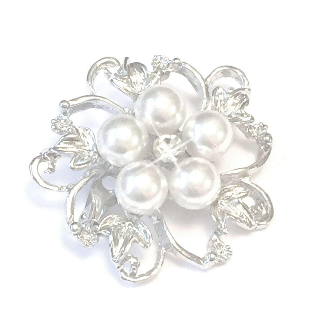 Pearl Flower Brooch, A quaint and sophisiticated brooch in an exquisite flower design, with silver toned metal petals and leaves that surround five round white faux pearls, with one sparkling crystal set in the centre