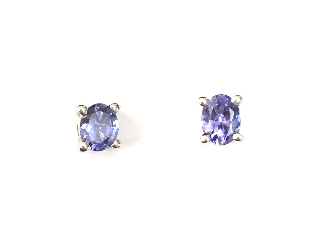 Tanzanite Sterling Silver Stud Earrings, An alluring and delightful pair of stud earrings created with 0.680 carats of tantalising Tanzanite of grade AA quality, in an oval design, set upon solid sterling silver earrings