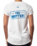 "Relaxed fit women's inspirational white raglan t-shirt with ""You Matter"" blue design back view"
