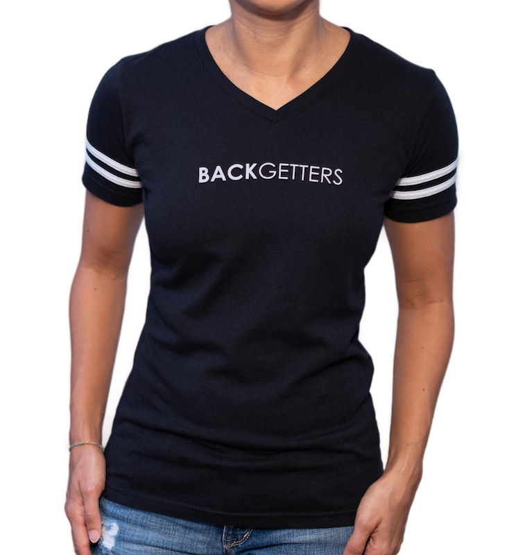 Your Obstacles Tees For Women | Front view of women's black varsity tee with two white stripes on sleeves and BackGetters in white across the chest