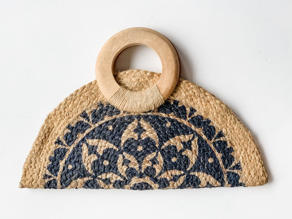 The Marisol Half Moon Jute Clutch in Navy
