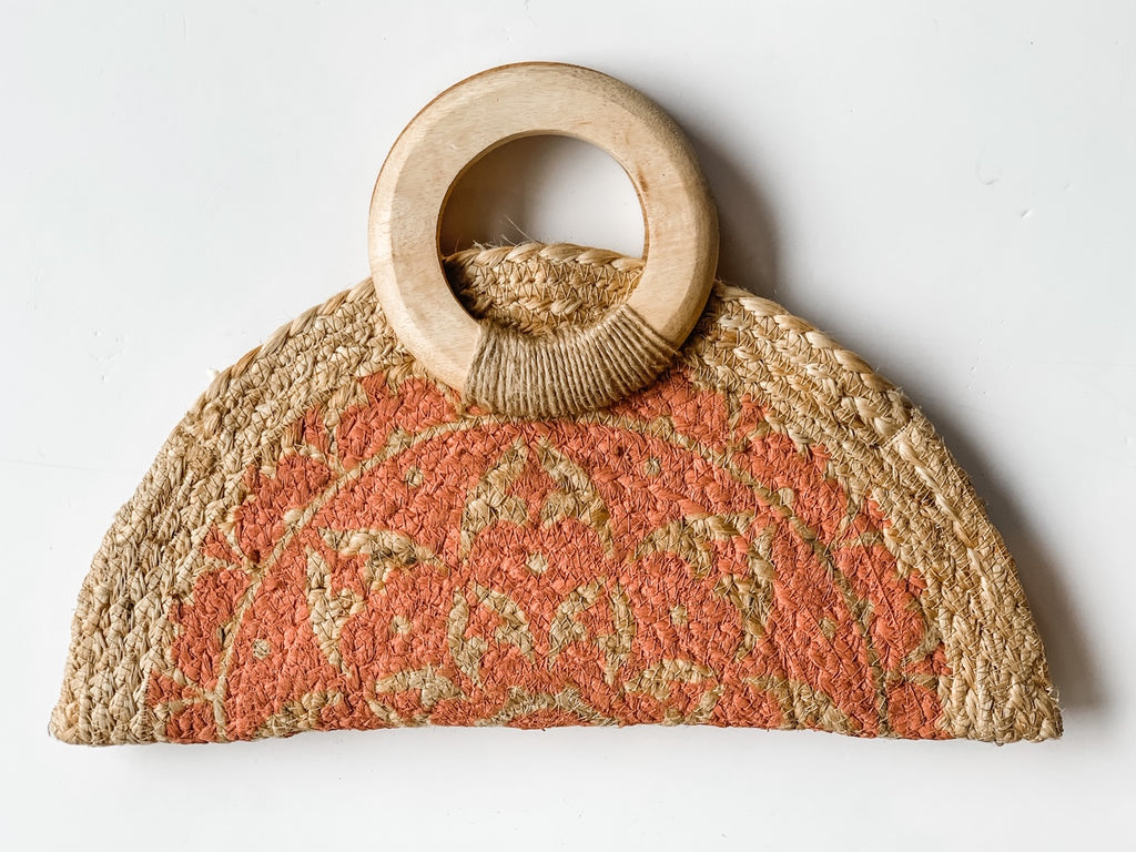 The Half Moon Jute Clutch in Coral