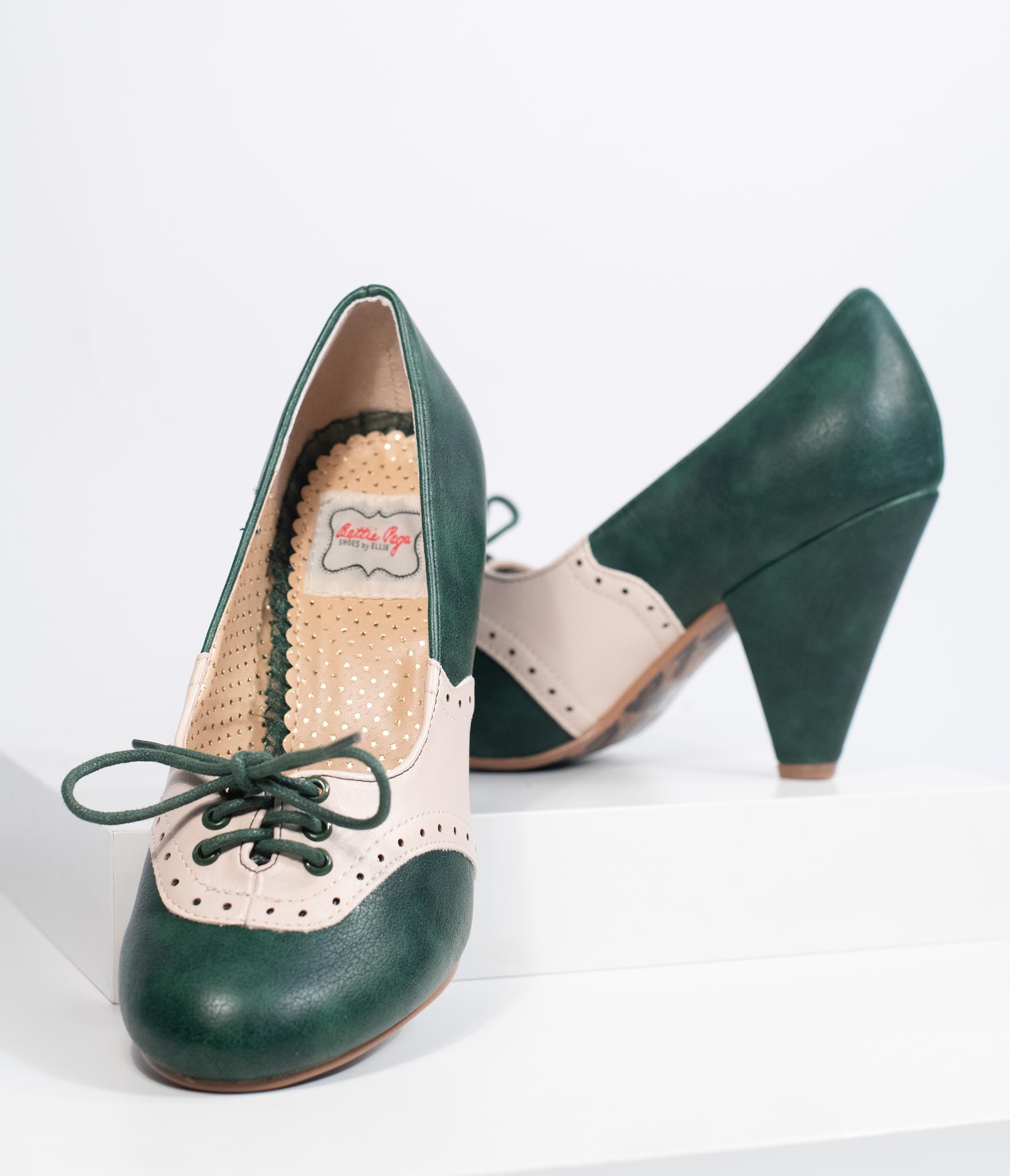 Rockabilly Shoes- Heels, Pumps, Boots, Flats Bettie Page Green  Ivory Leatherette Carole Oxford Saddle Heels $74.00 AT vintagedancer.com