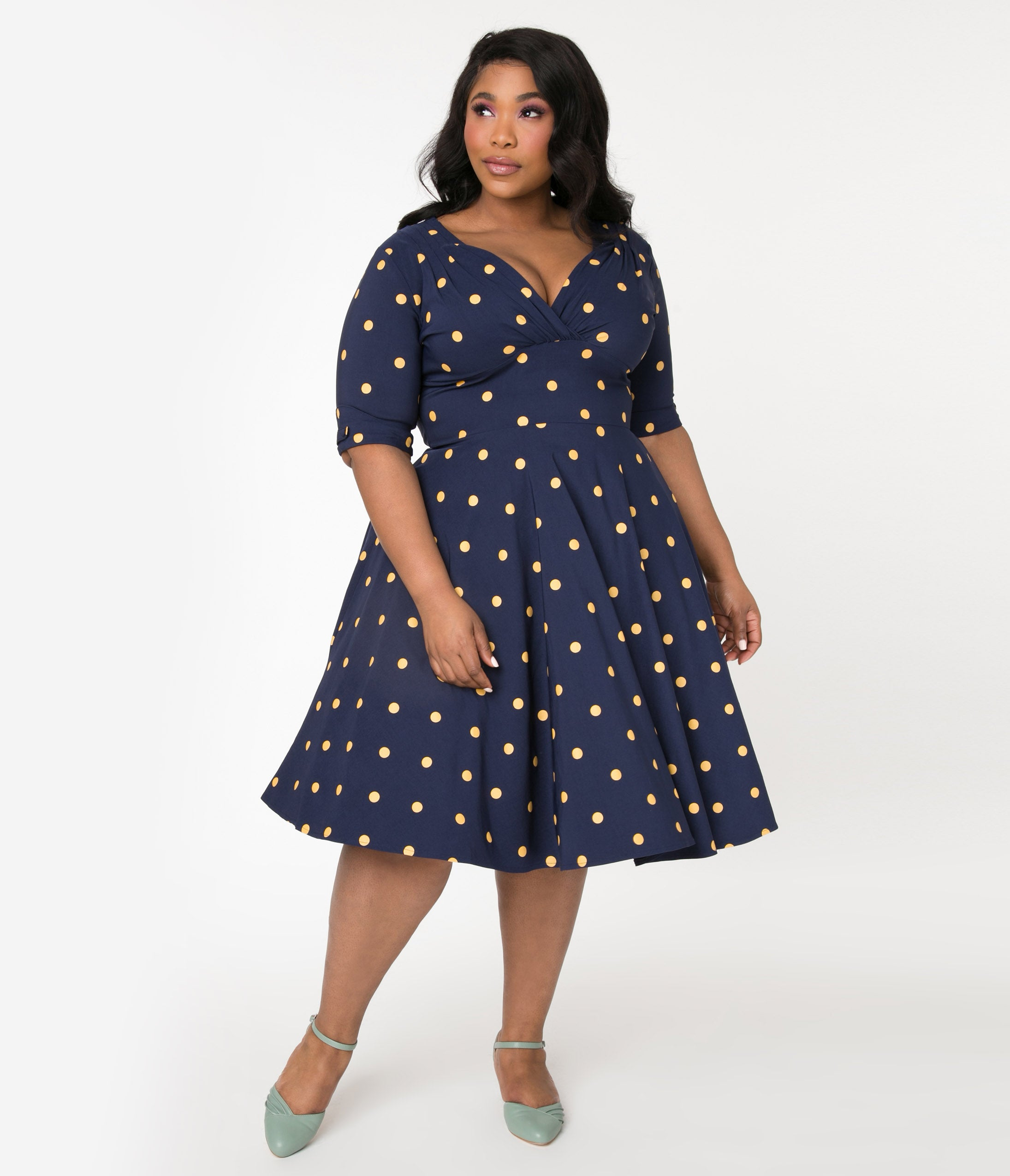 1950s Plus Size Fashion & Clothing History Unique Vintage Plus Size Navy  Mustard Polka Dot Delores Swing Dress With Sleeves $92.00 AT vintagedancer.com