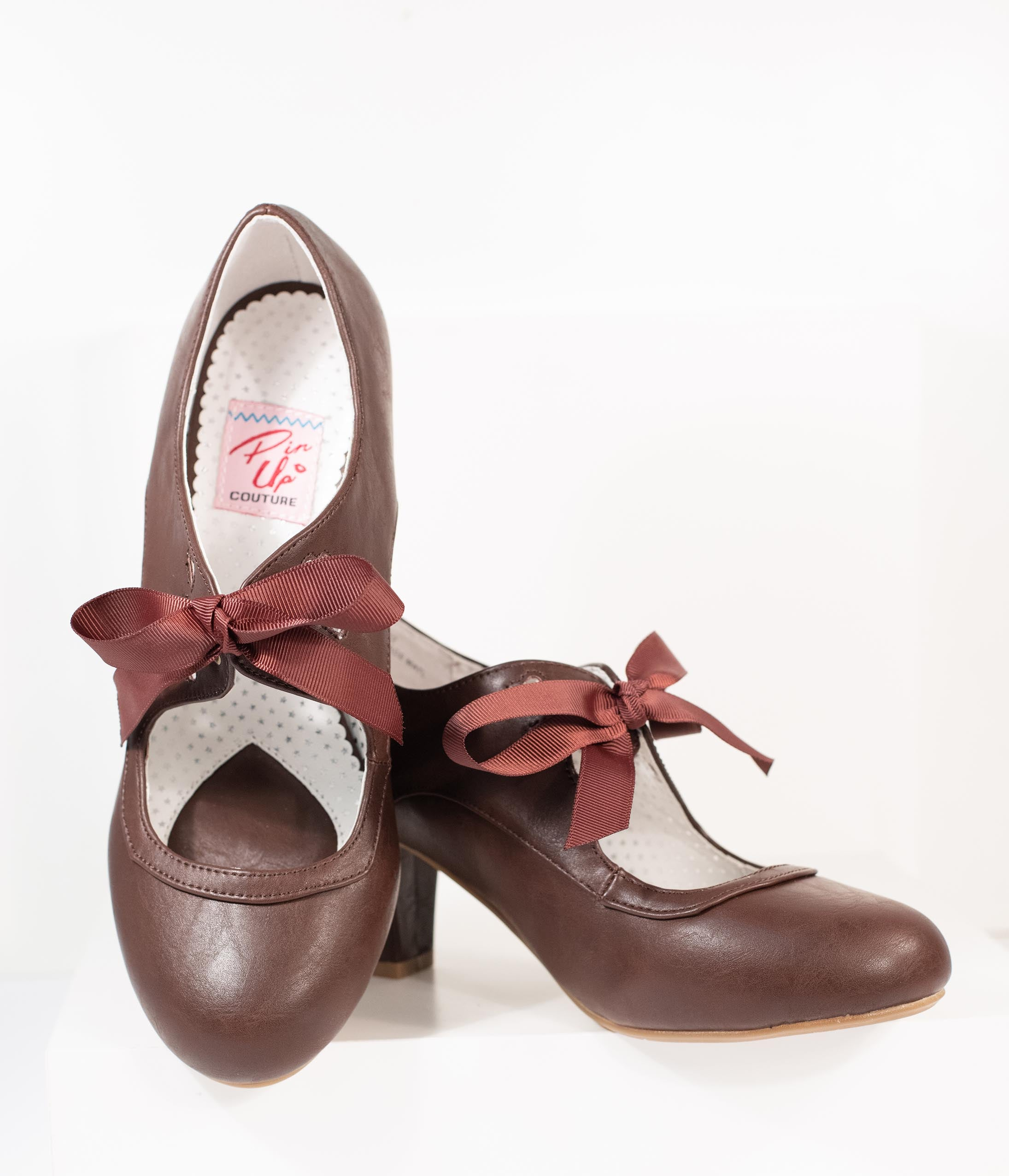Vintage Shoes, Vintage Style Shoes Vintage Style Dark Brown Leatherette Wiggle Bow Heels $66.00 AT vintagedancer.com