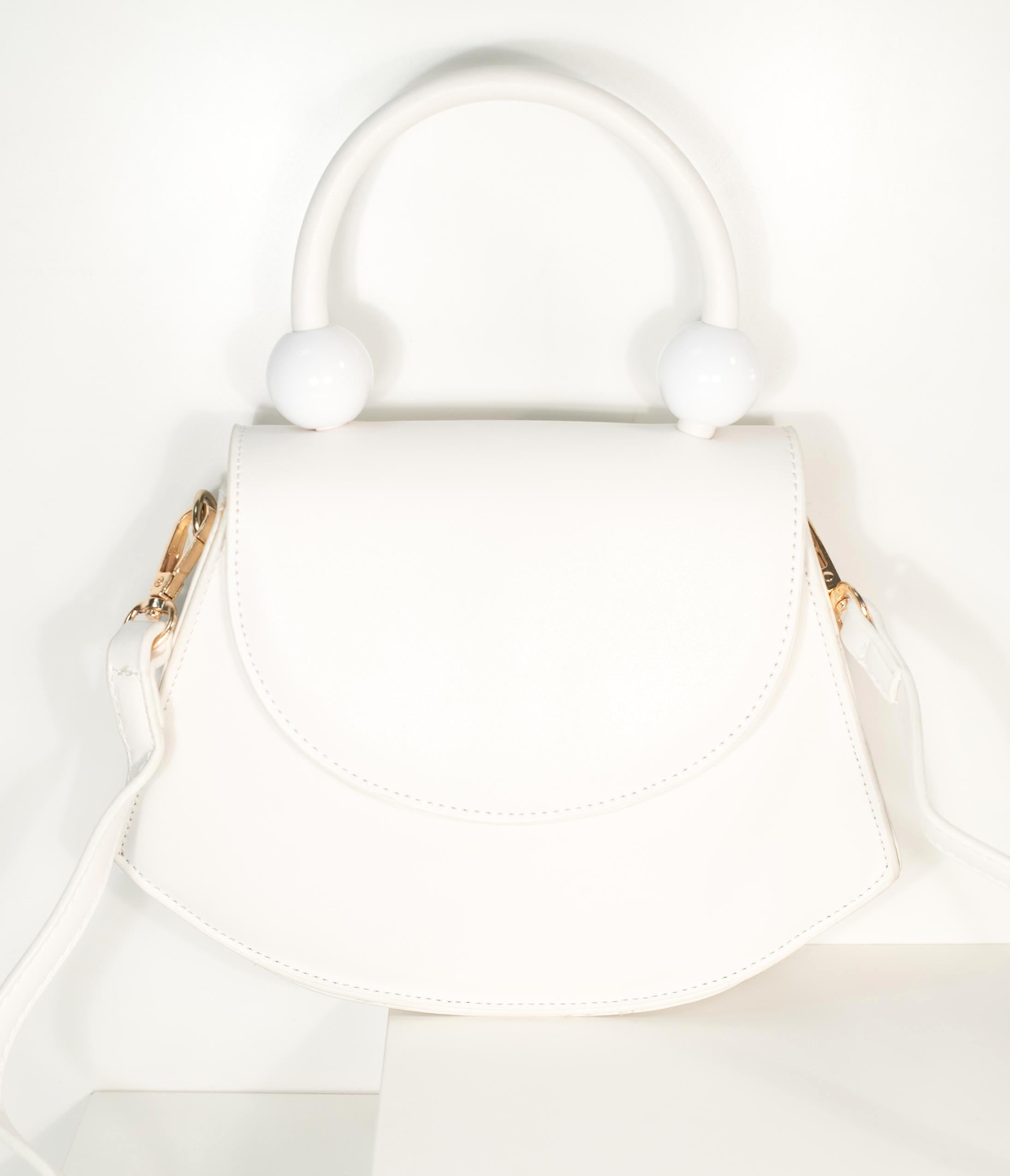 1950s Handbags, Purses, and Evening Bag Styles Vintage Style Ivory Leatherette Crescent Purse $48.00 AT vintagedancer.com