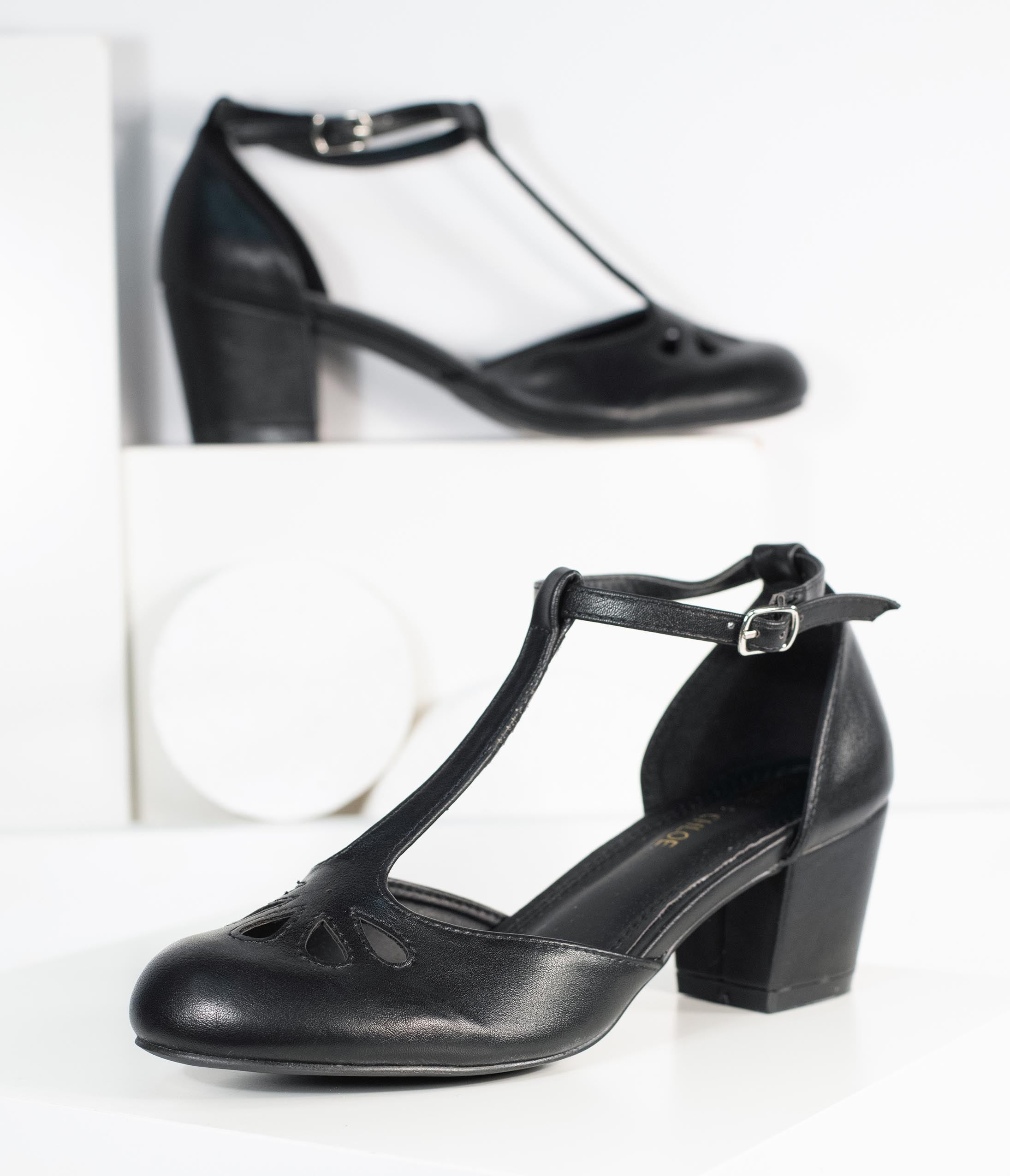 Women's 1920s Shoe Styles and History Black Leatherette Minny T-Strap Heels $48.00 AT vintagedancer.com