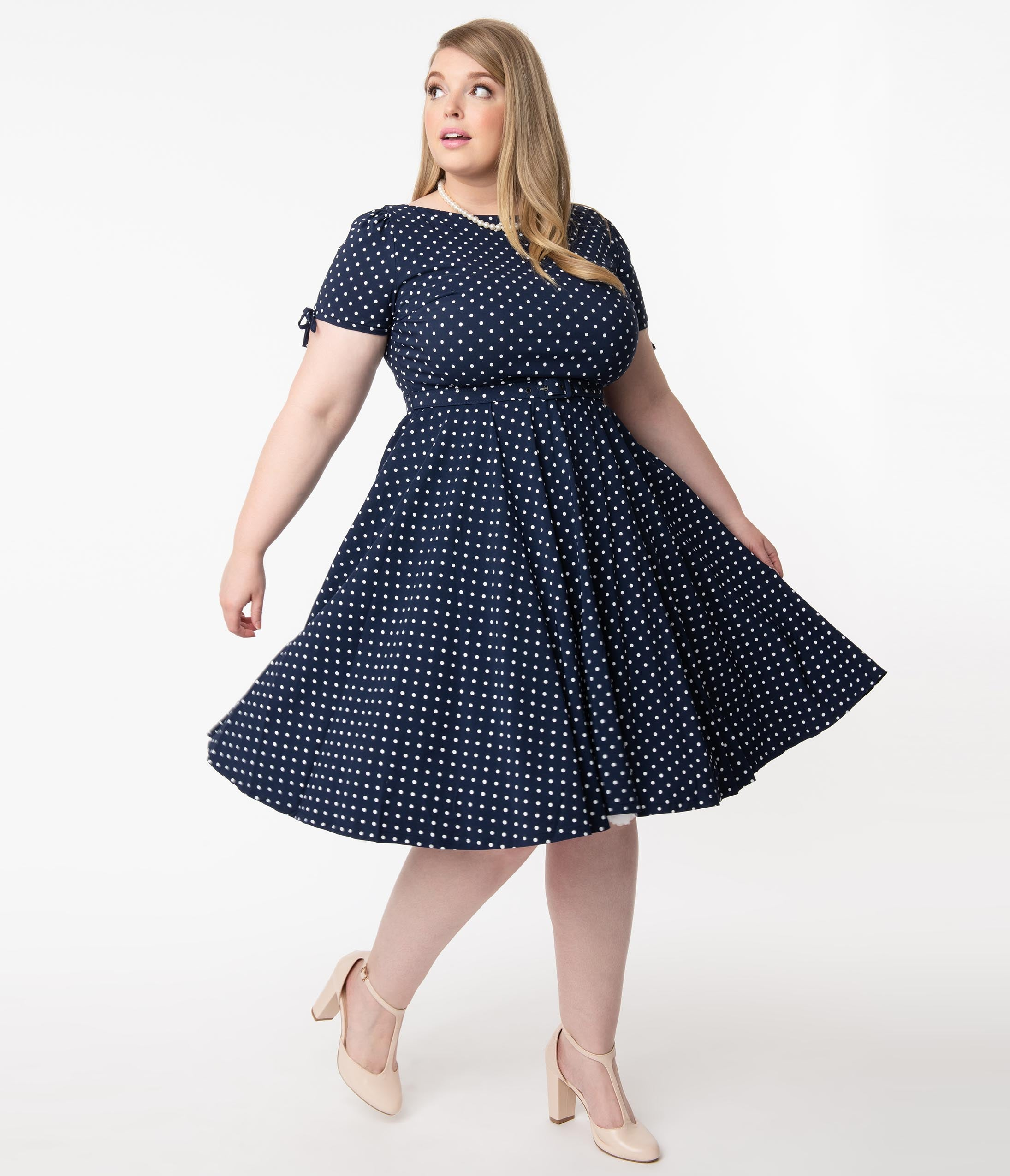 1950s Plus Size Fashion & Clothing History Unique Vintage Plus Size Navy  White Pin Dot Sasha Swing Dress $82.00 AT vintagedancer.com