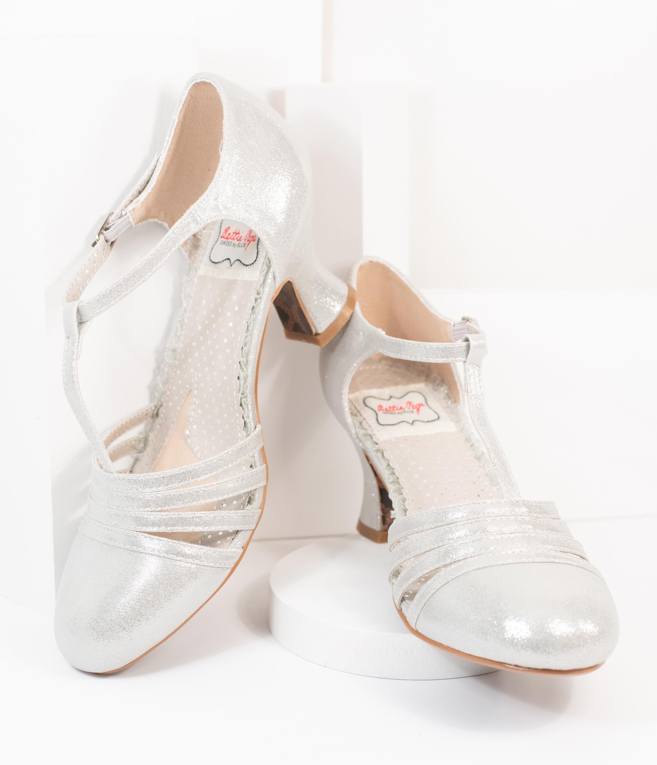 Pin Up Shoes- Heels, Pumps & Flats Bettie Page Metallic Silver Sammy T-Strap Heels $78.00 AT vintagedancer.com
