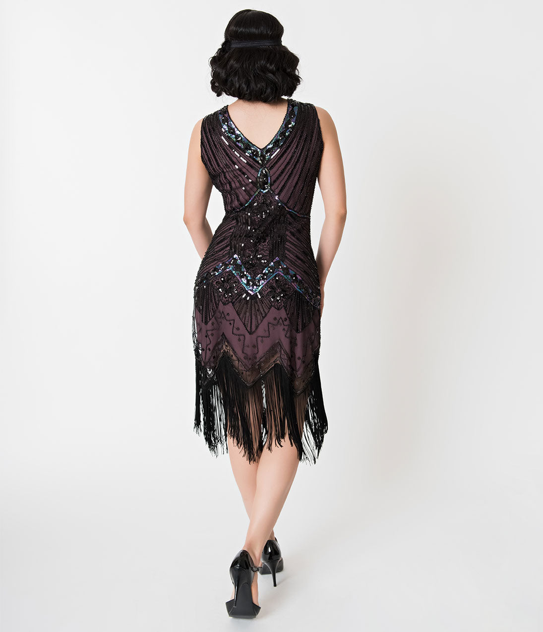 1920s deco vintage black silk lace gown with flared hem and matching long mitts.