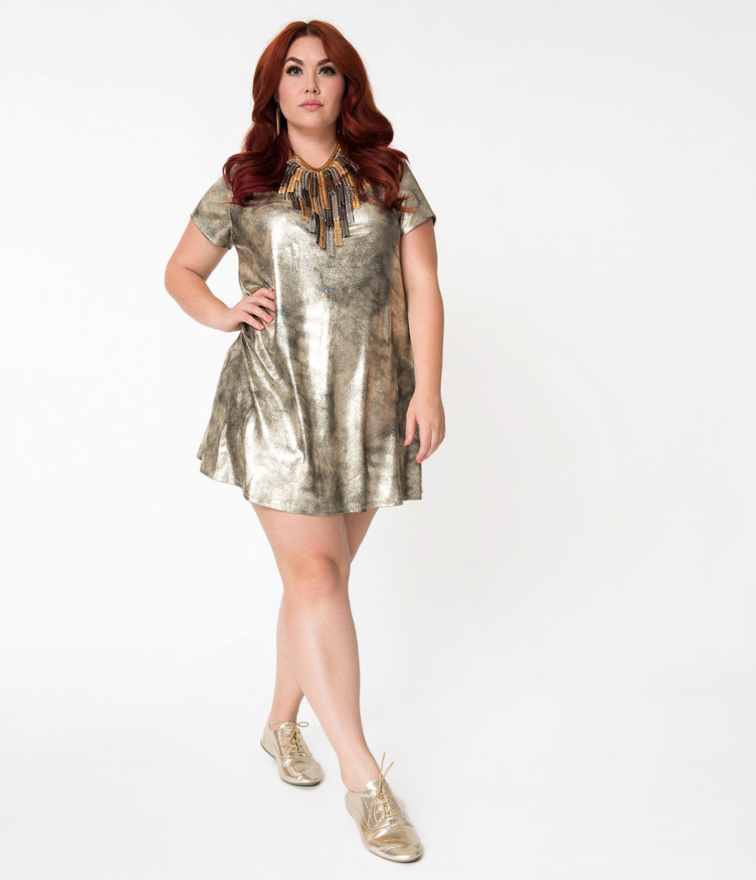 1960s Dresses – A Rainbow of 50 Dresses (Pictures) Plus Size Metallic Brushed Gold Sleeved Shift Dress $48.00 AT vintagedancer.com