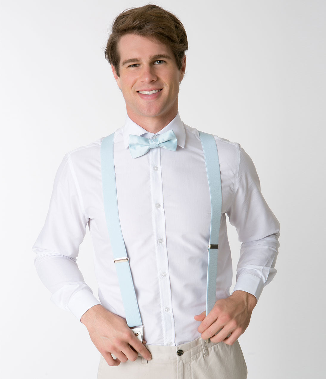 Baby Blue Adjustable Suspenders Crisp and classy, brighten your vintage ensemble with these brilliant baby blue suspenders! Adjustable straps allow for a comfy fit while the silver metal clips keep you going through the day. We're feeling dapper, darling!.Available while supplies last | Baby Blue Adjustable Suspenders
