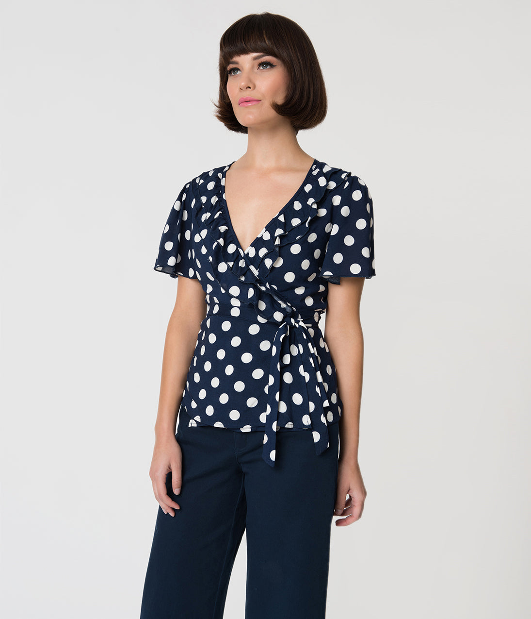 Vintage & Retro Shirts, Halter Tops, Blouses Retro Style Navy Blue  White Polka Dot Ruffled Short Sleeve Wrap Blouse $26.00 AT vintagedancer.com