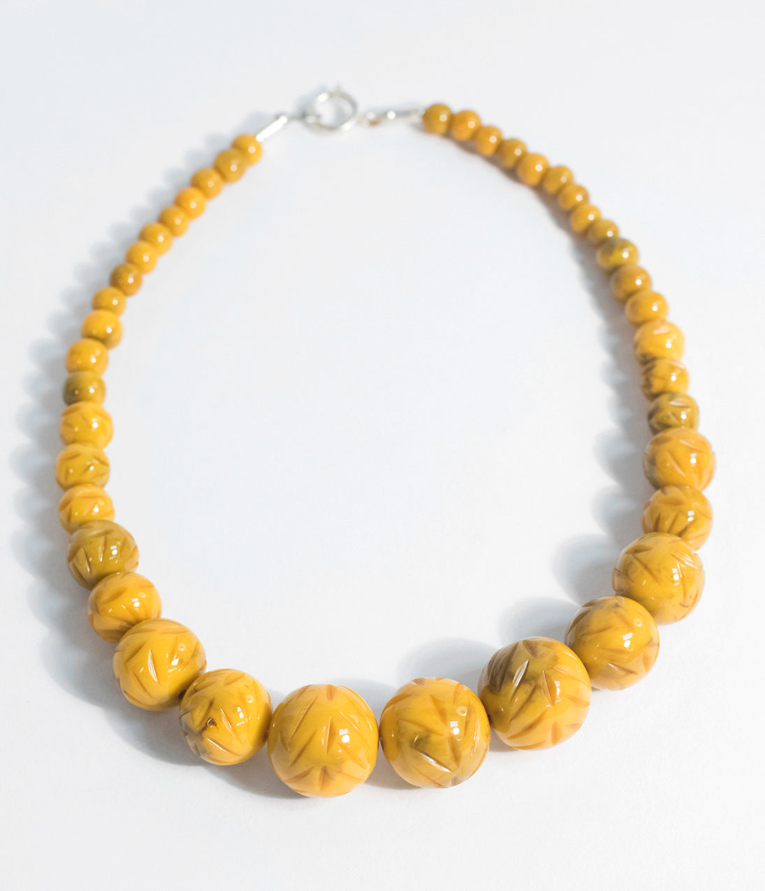 50s Jewelry: Earrings, Necklace, Brooch, Bracelet Banana Yellow Carved Resin Beaded Necklace $28.00 AT vintagedancer.com