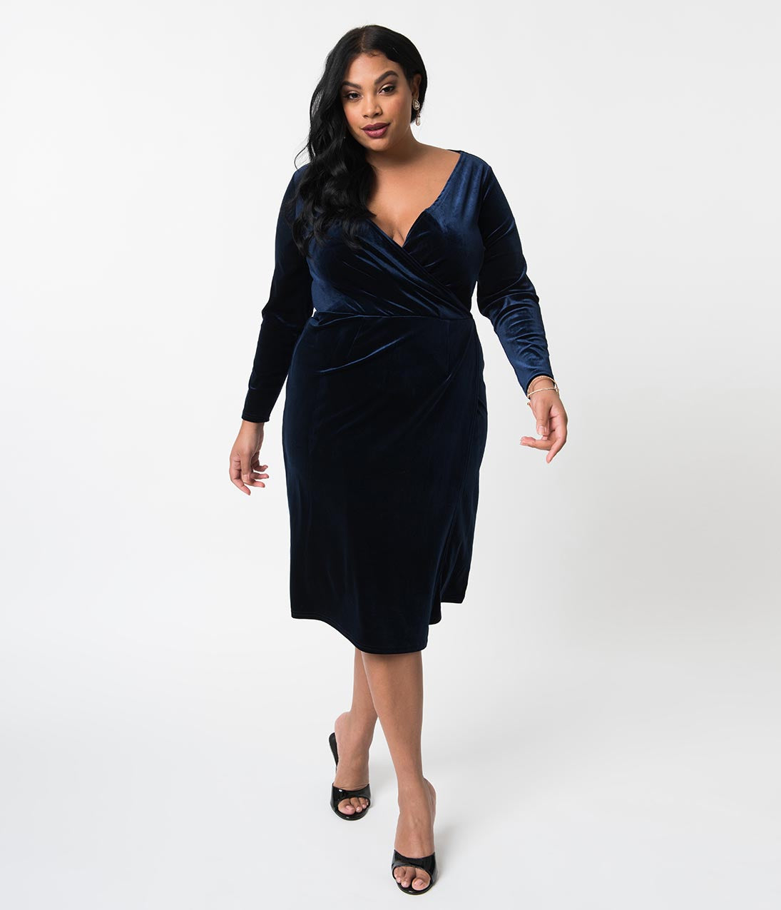 1940s Plus Size Fashion: Style Advice from 1940s to Today Unique Vintage Plus Size Navy Blue Velvet Long Sleeve Damsel Wiggle Dress $74.00 AT vintagedancer.com