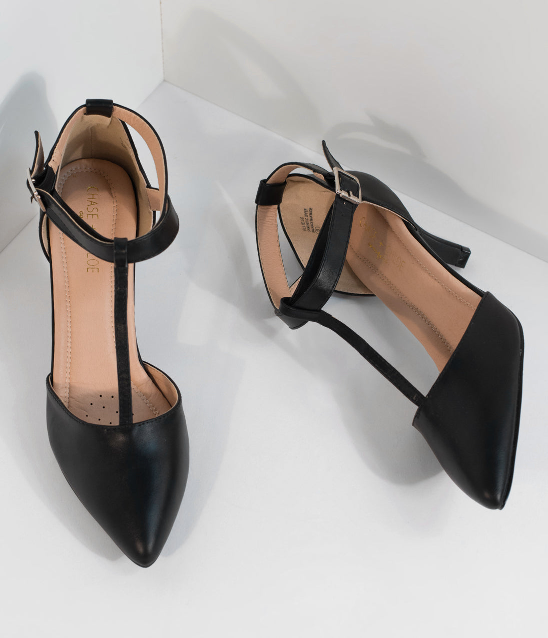 Vintage Style Shoes, Vintage Inspired Shoes Black Leatherette Pointed Toe Ellie T-Strap Heels $46.00 AT vintagedancer.com