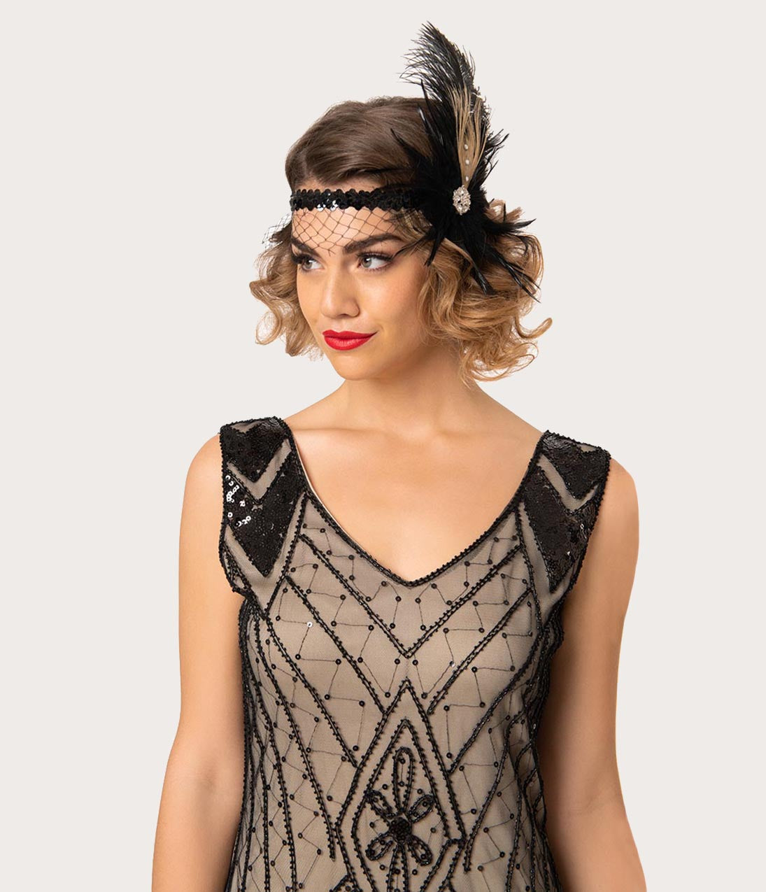 1920s Hairstyles History- Long Hair to Bobbed Hair Black Sequin Netted Roaring 20S Feather Headpiece $24.00 AT vintagedancer.com