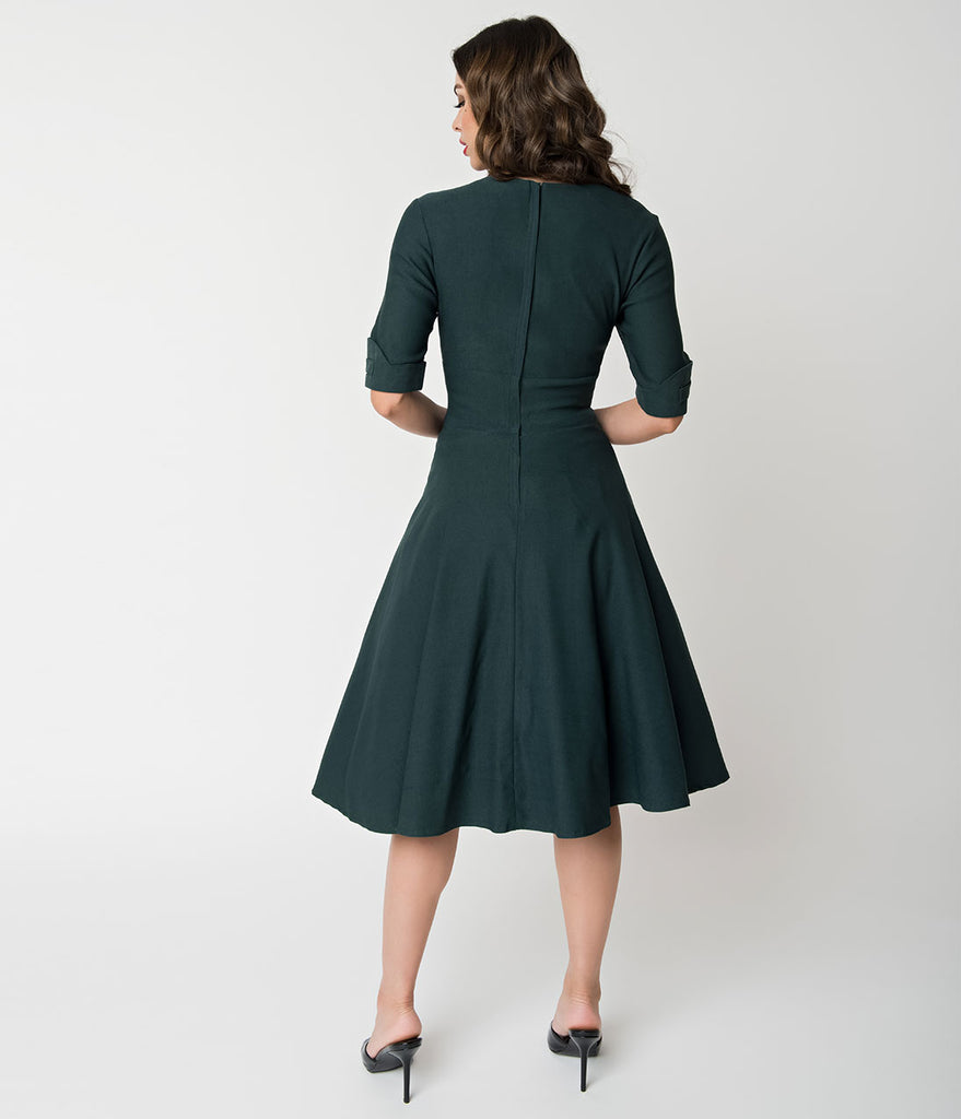 Unique Vintage 1950s Dark Green Delores Swing Dress with Sleeves