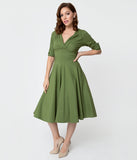 Unique Vintage 1950s Moss Green Delores Swing Dress with Sleeves
