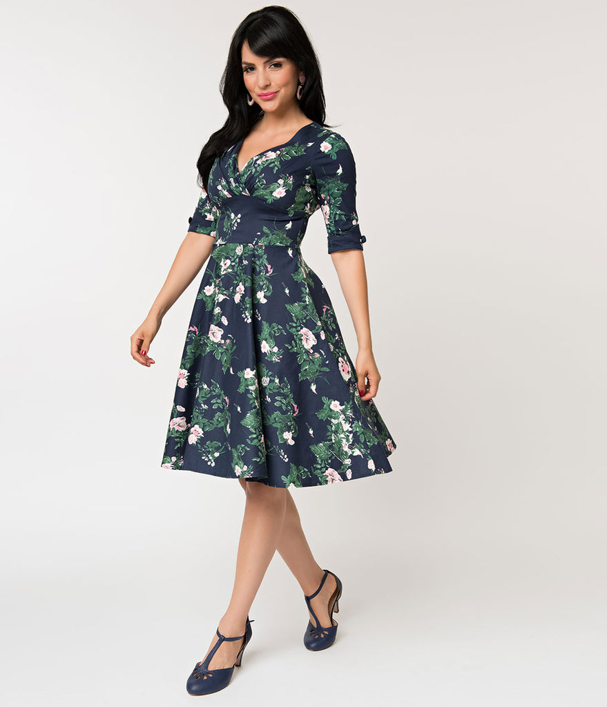 e2f2aa803d3 Unique Vintage 1950s Navy   Pink Floral Print Delores Swing Dress with