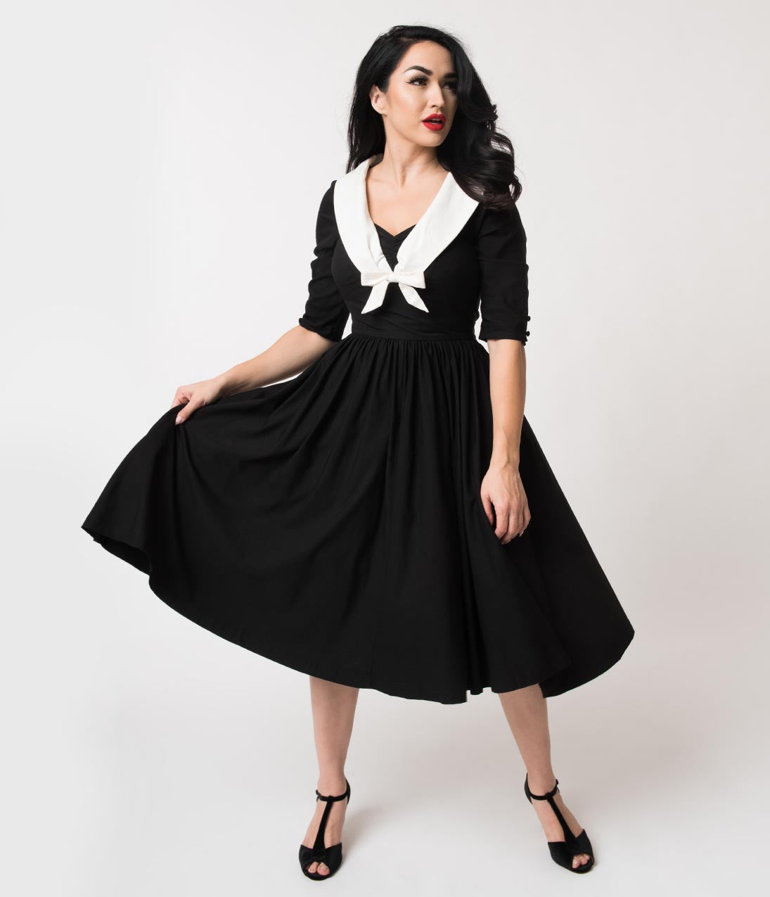 1950s Fashion History: Women's Clothing Unique Vintage 1950S Style Black  White Half Sleeve Julien Swing Dress $98.00 AT vintagedancer.com