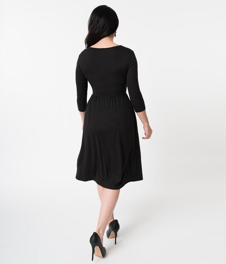 7076c220588d Vintage Style Black Surplice Knit Sleeved Casual Dress. Quick View