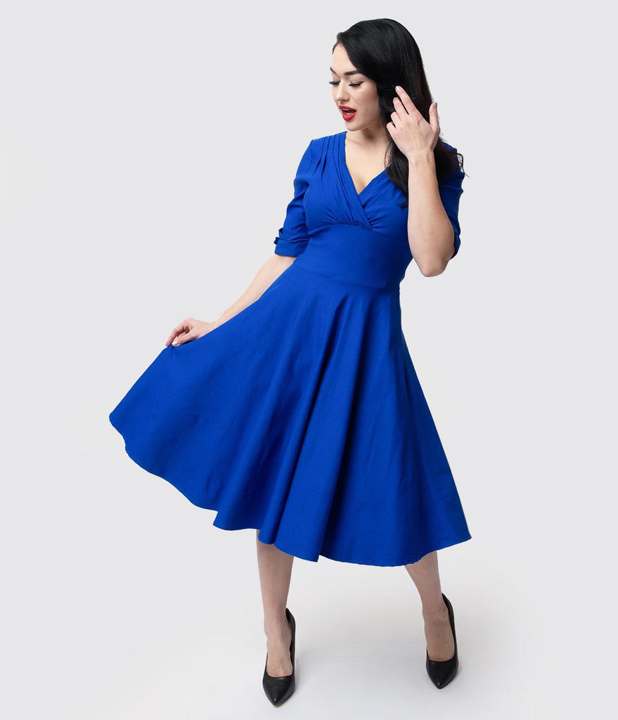 d83fd6dd47c7 Unique Vintage 1950s Royal Blue Delores Swing Dress with Sleeves