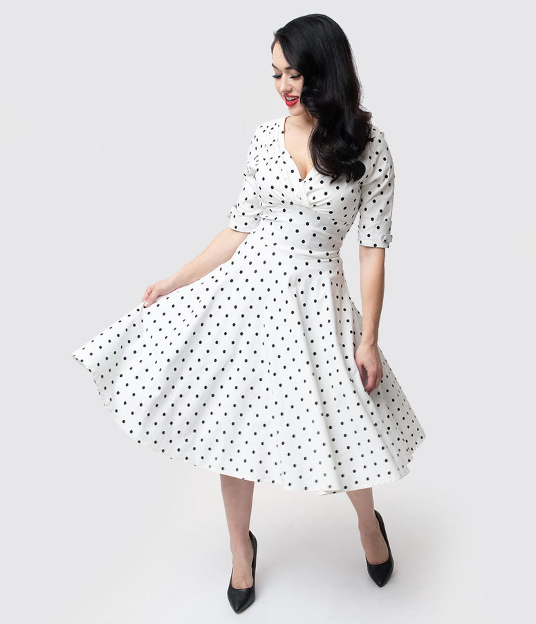 e5cfb583629c3 Unique Vintage 1950s White   Black Dot Delores Swing Dress with Sleeves