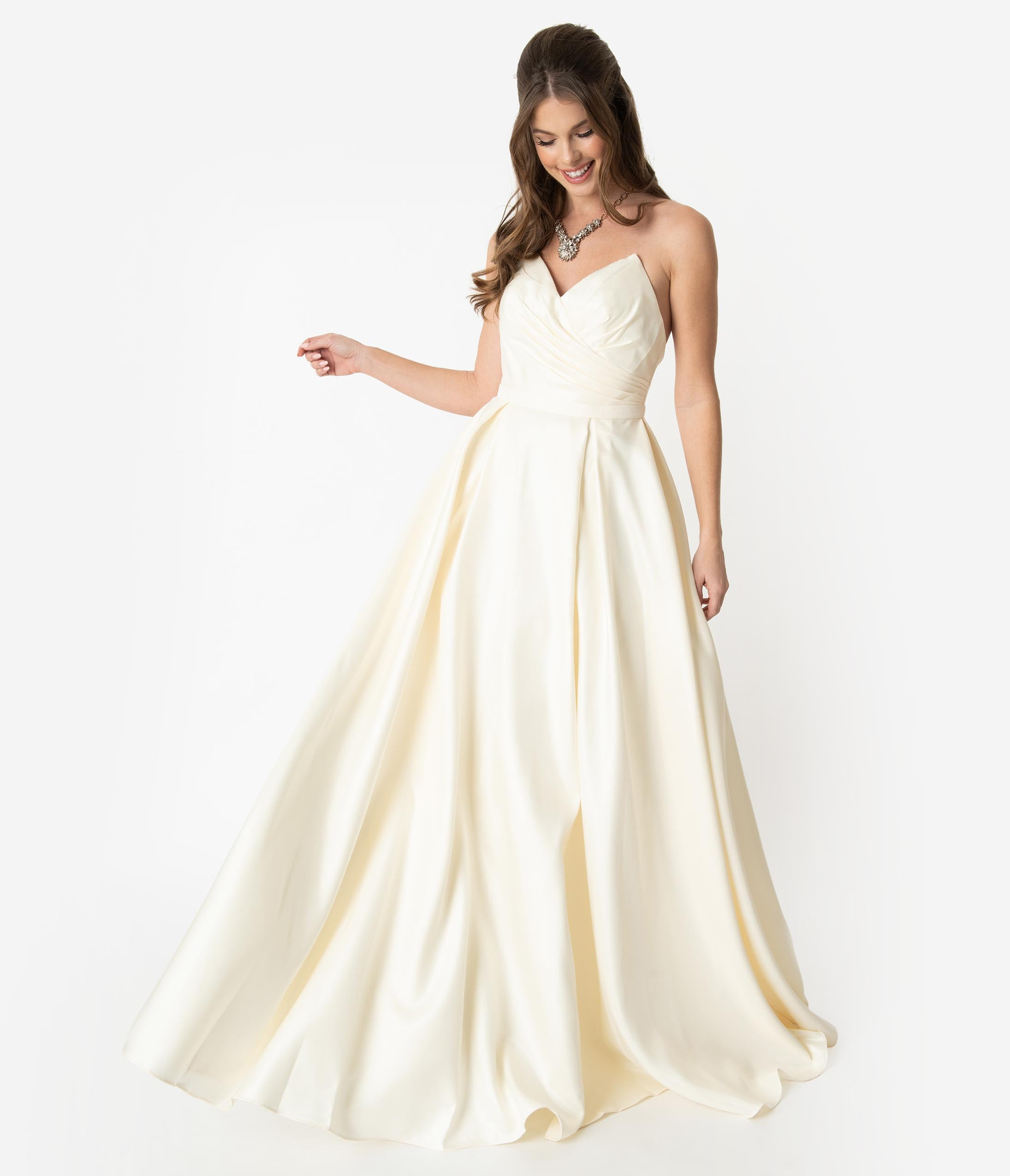 1950s History of Prom, Party, and Formal Dresses Cream Satin Pleated Pointed Sweetheart Strapless Wedding Gown $174.00 AT vintagedancer.com