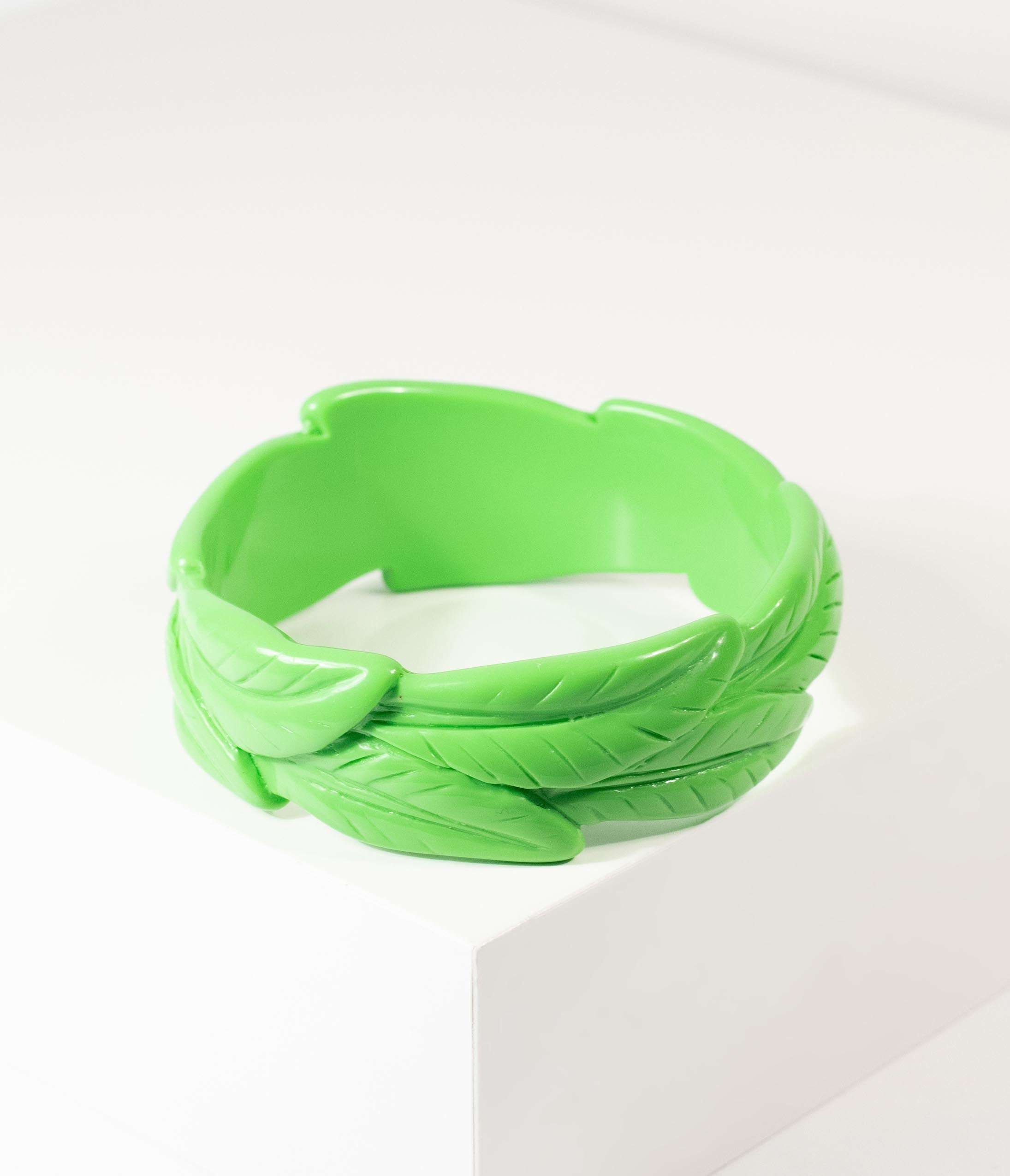 1950s Jewelry Styles and History Green Tropical Leaf Carved Resin Bangle Bracelet $17.00 AT vintagedancer.com