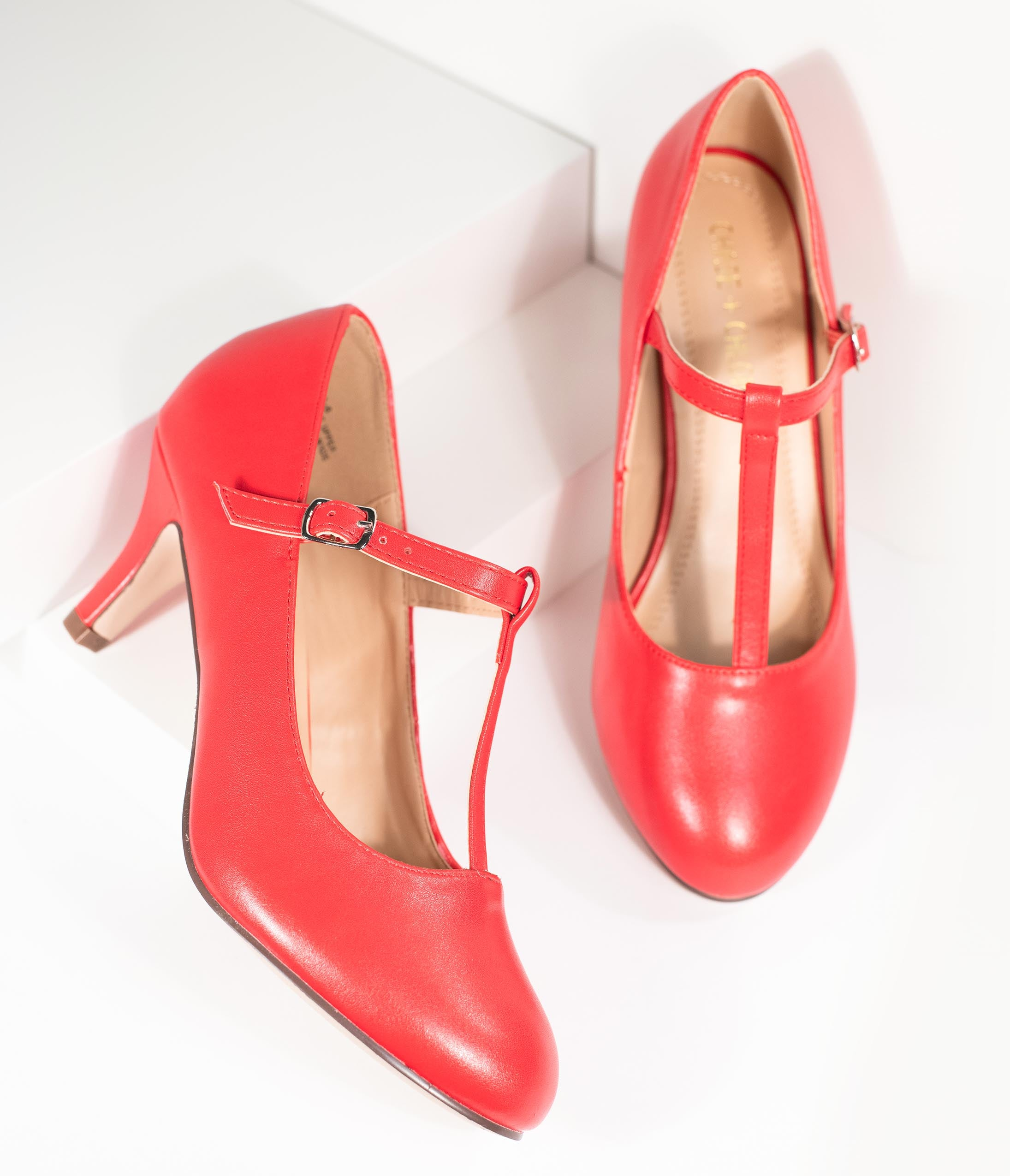 1950s Shoe Styles: Heels, Flats, Sandals, Saddles Shoes Vintage Style Red Leatherette T-Strap Heels $46.00 AT vintagedancer.com