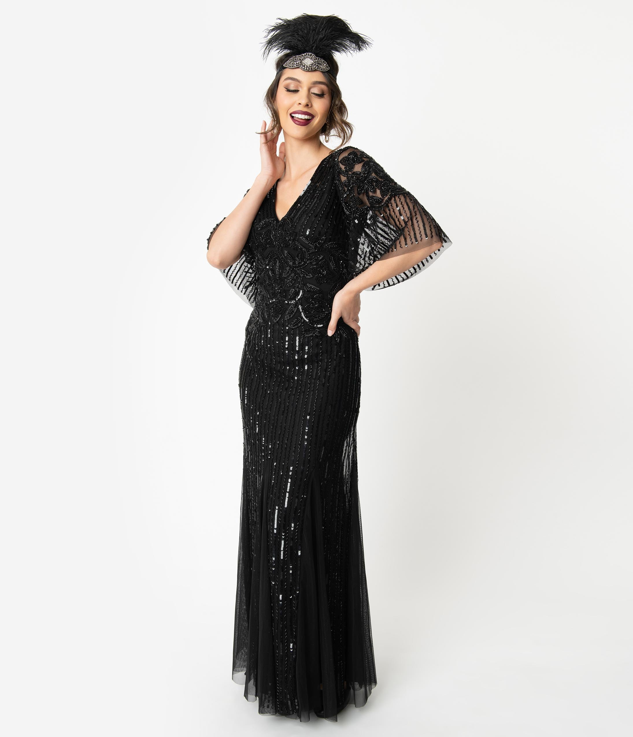 Vintage Evening Dresses and Formal Evening Gowns 1920S Style Black Beaded Sleeved Norma Flapper Gown $268.00 AT vintagedancer.com