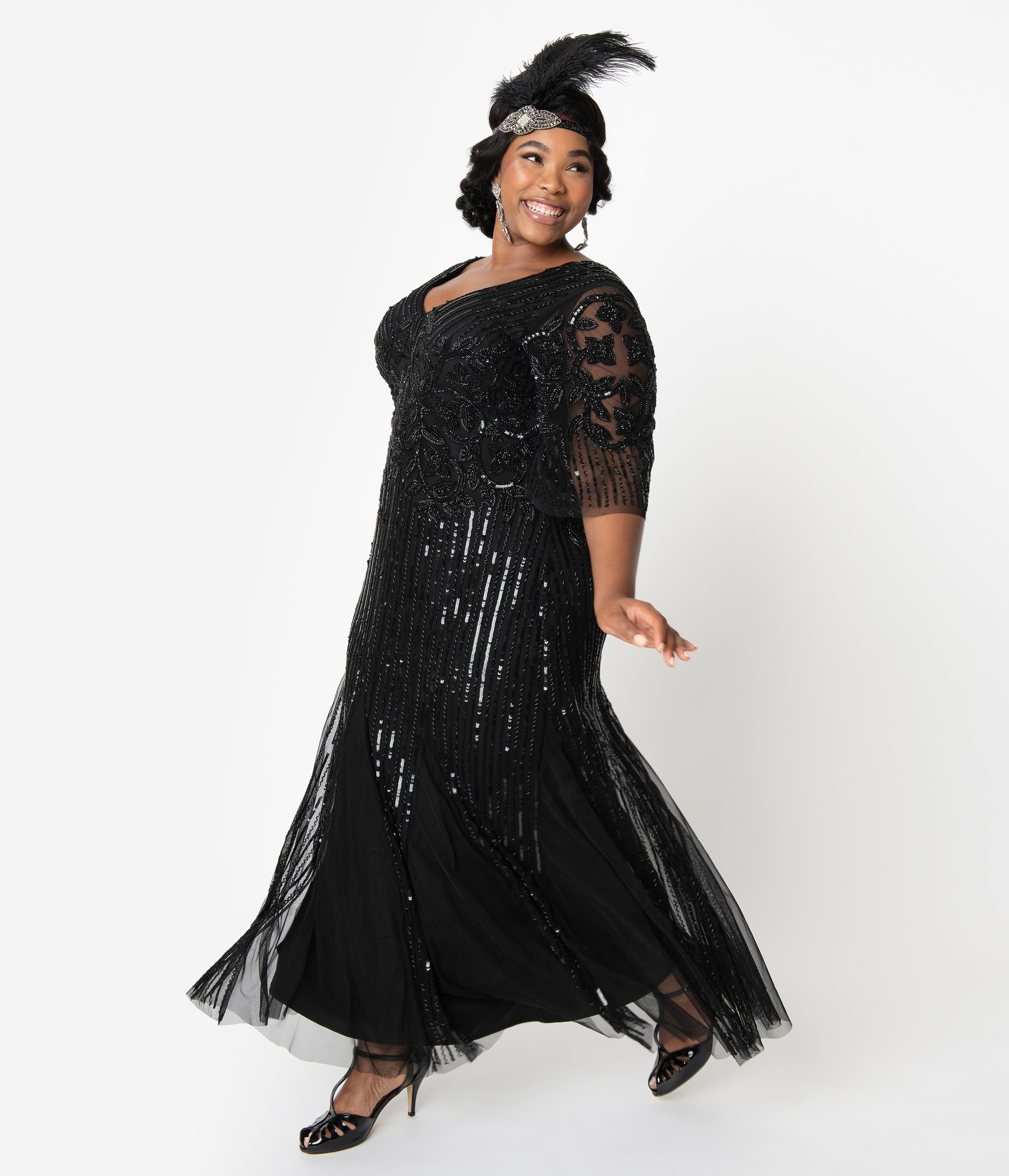 1920s Plus Size Flapper Dresses, Gatsby Dresses, Flapper Costumes Plus Size 1920S Style Black Beaded Sleeved Norma Flapper Gown $268.00 AT vintagedancer.com