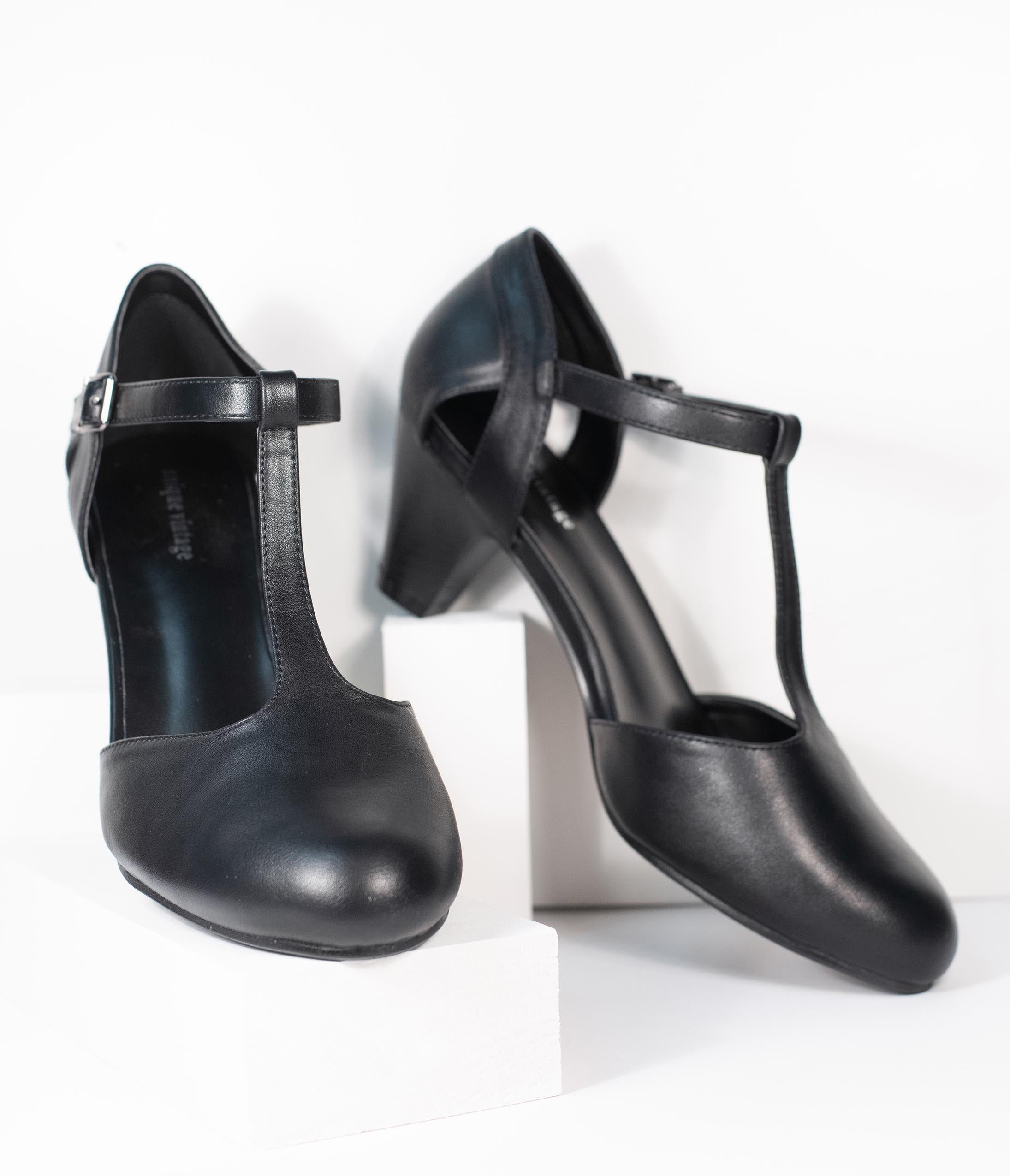 Women's 1920s Shoe Styles and History Unique Vintage Black Leatherette Closed Toe T-Strap Roxy Pumps $48.00 AT vintagedancer.com