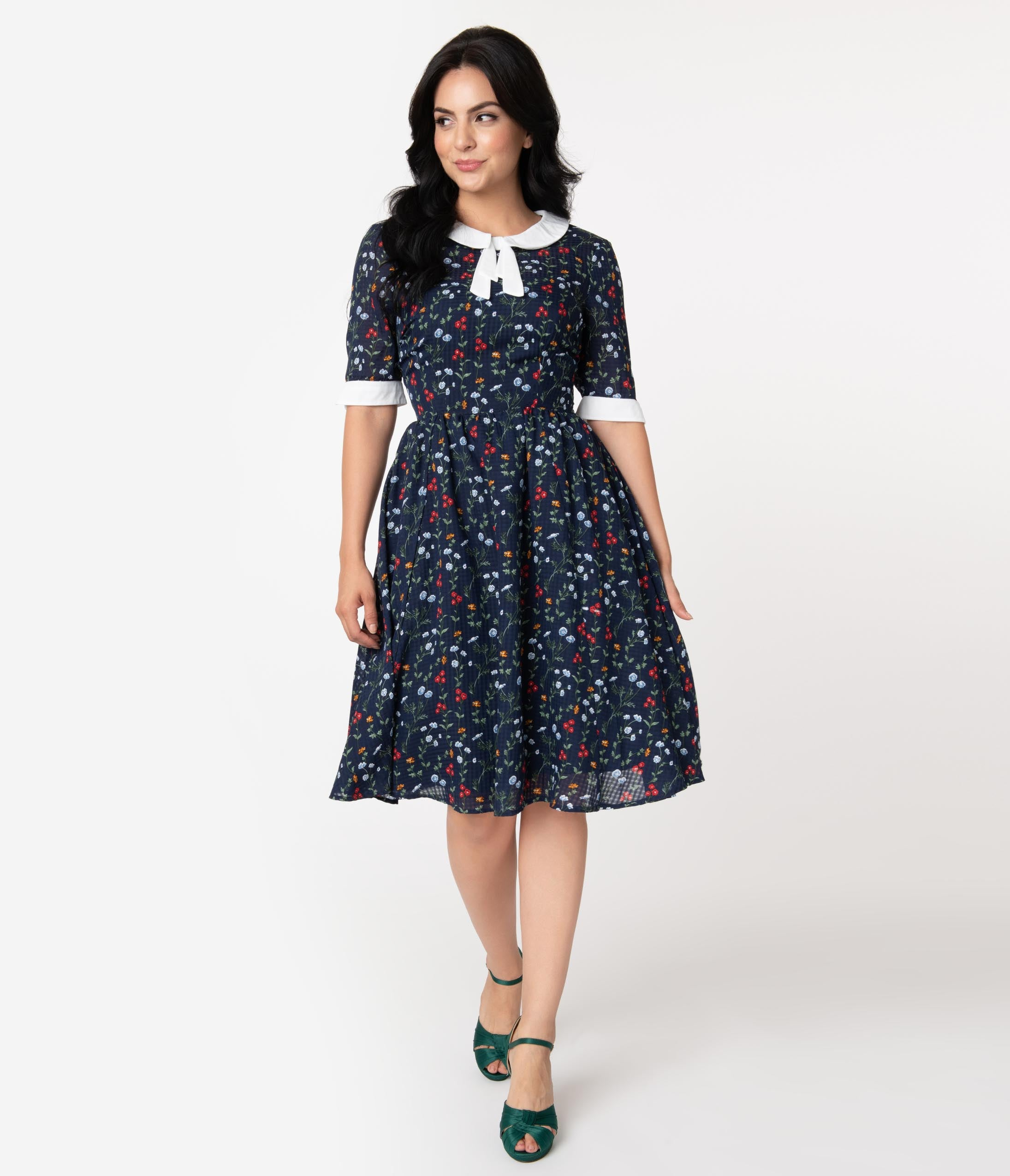 Fifties Dresses : 1950s Style Swing to Wiggle Dresses Unique Vintage 1950S Style Navy Floral Francine Swing Dress $98.00 AT vintagedancer.com
