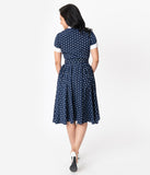 I Love Lucy x Unique Vintage Navy & White Polka Dot Ricardo Swing Dress