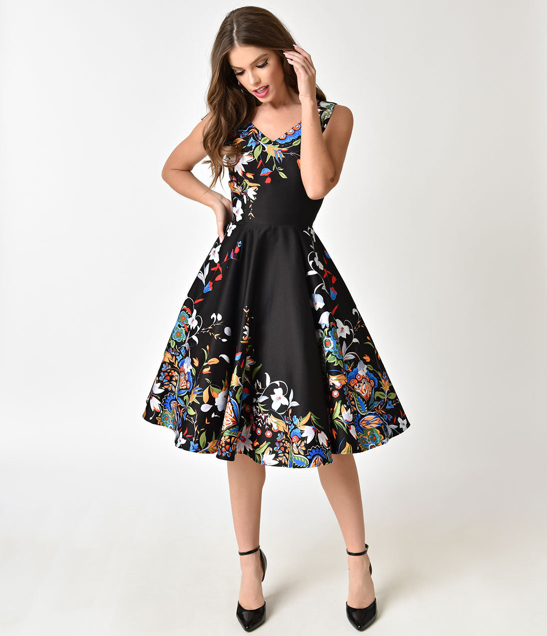 Vintage 50s Dresses: 8 Classic Retro Styles Black Double Border Floral Print Cotton Swing Dress $78.00 AT vintagedancer.com