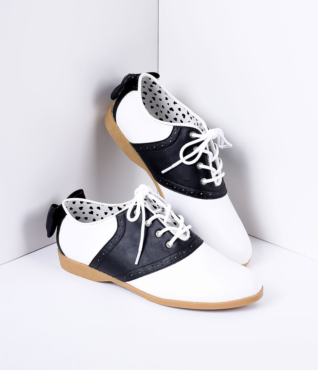 Retro Vintage Flats and Low Heel Shoes Black  White Classic Lace Up Bow Saddle Shoes $48.00 AT vintagedancer.com