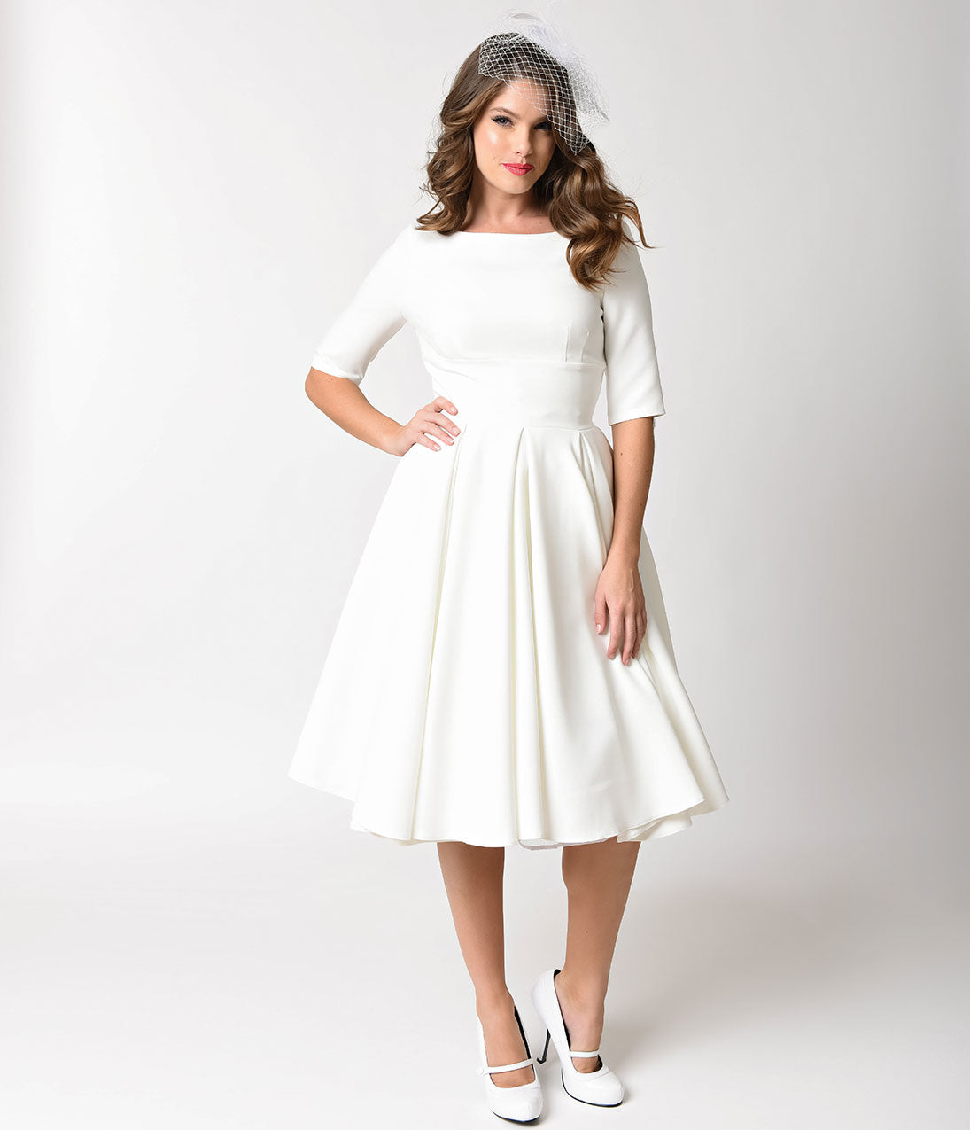 50s Wedding Dress, 1950s Style Wedding Dresses, Rockabilly Weddings The Pretty Dress Company Ivory Crepe Sleeved Hepburn Swing Dress $172.00 AT vintagedancer.com