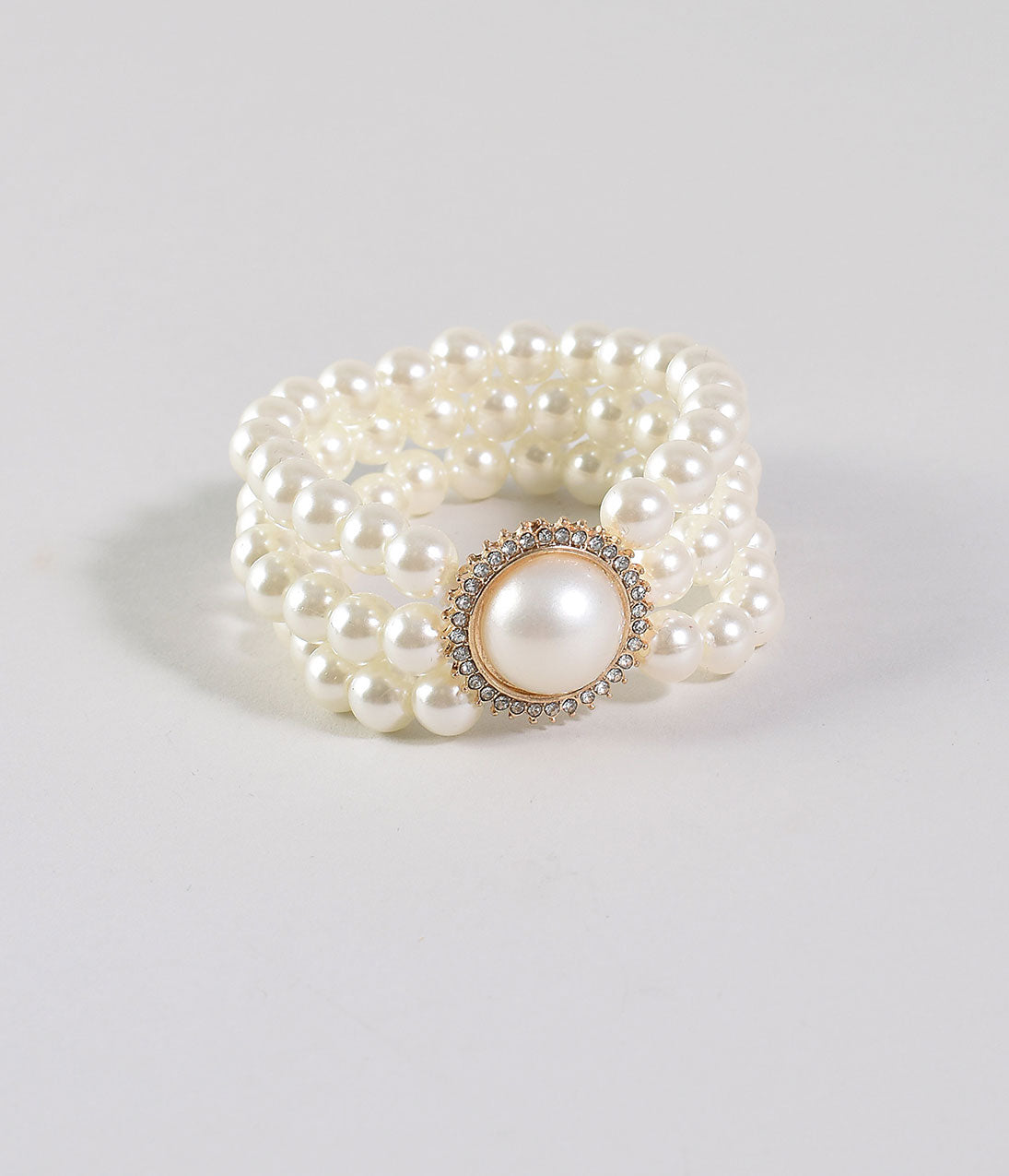 Vintage Style Jewelry, Retro Jewelry Ivory Pearl Three Strand Stretch Bracelet $24.00 AT vintagedancer.com