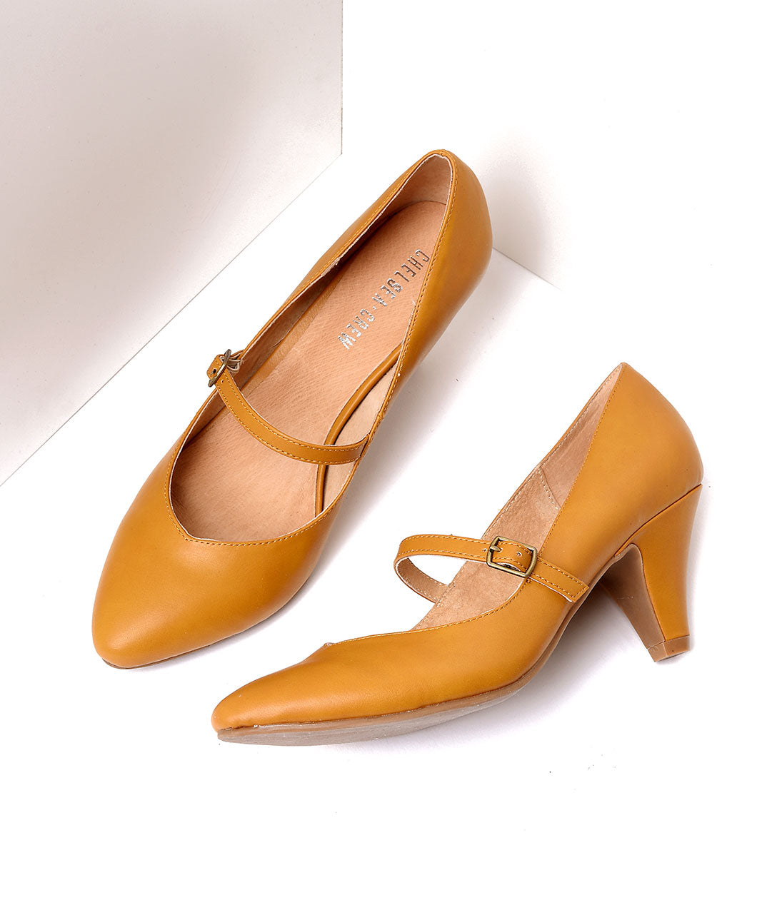 1950s Shoe Styles: Heels, Flats, Sandals, Saddles Shoes Mustard Yellow Leatherette Mary Jane Pumps $62.00 AT vintagedancer.com