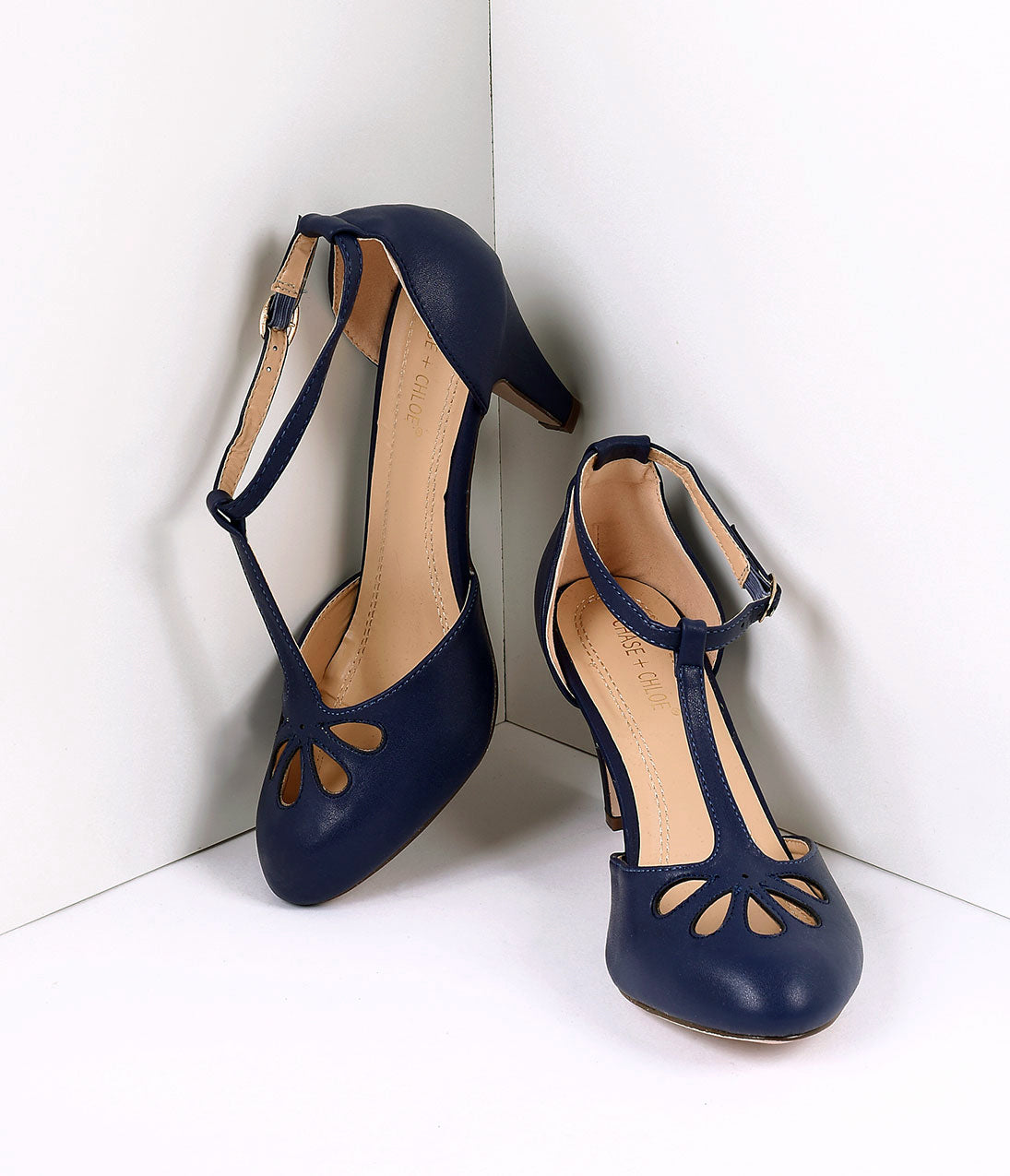 1950s Shoe Styles: Heels, Flats, Sandals, Saddles Shoes Navy Blue Pleather Cutout Kimmy T-Strap Heels $44.00 AT vintagedancer.com