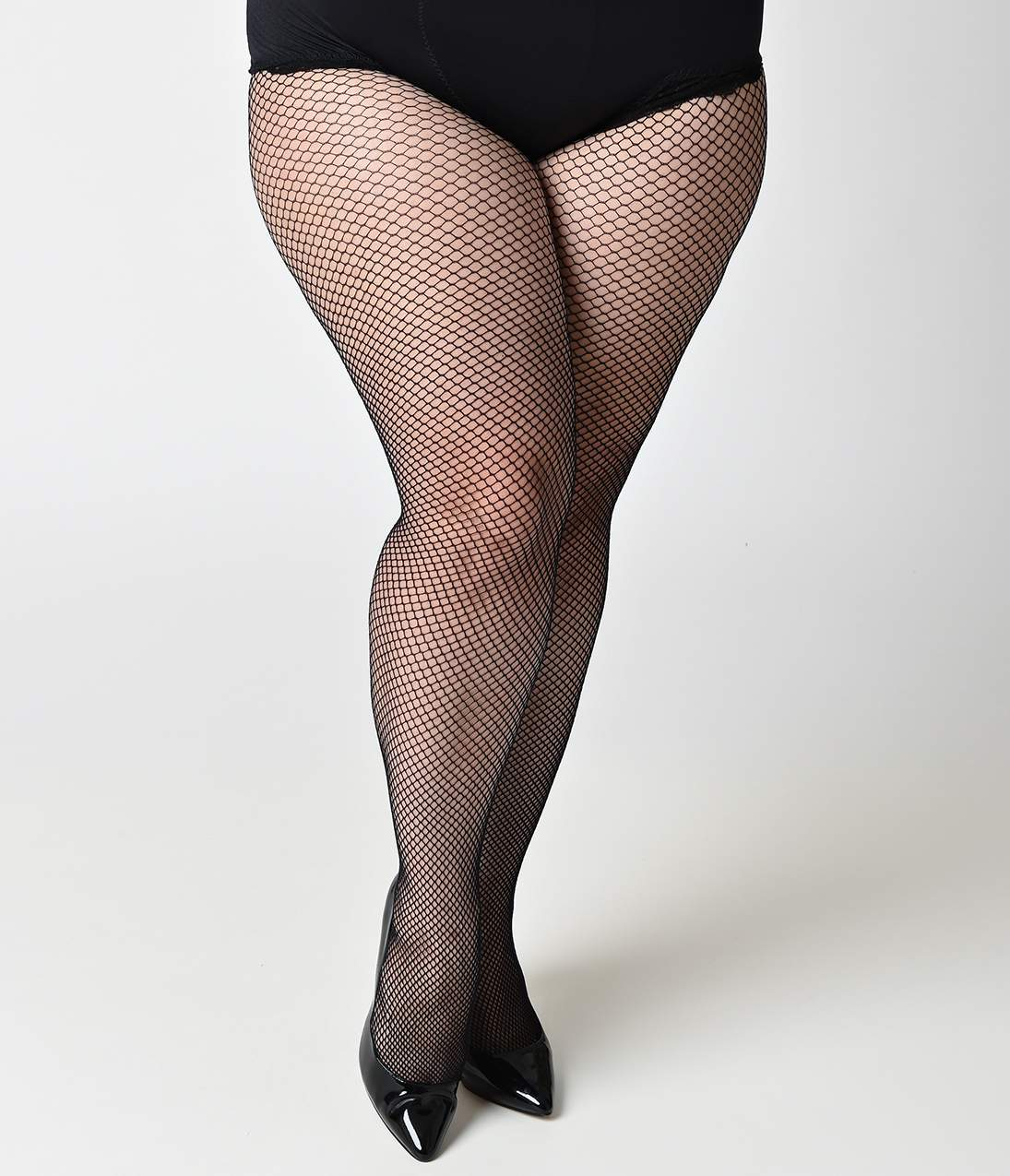 1960s Tights, Stockings, Panty Hose, Knee High Socks Plus Size Black Fishnet Tights $10.00 AT vintagedancer.com